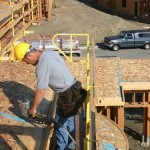 Two plank system: The WHALEN-JACK scaffolding has provided a safe Fall Protection Work platform while workers installed trusses, blocking, fascia and roof sheathing.